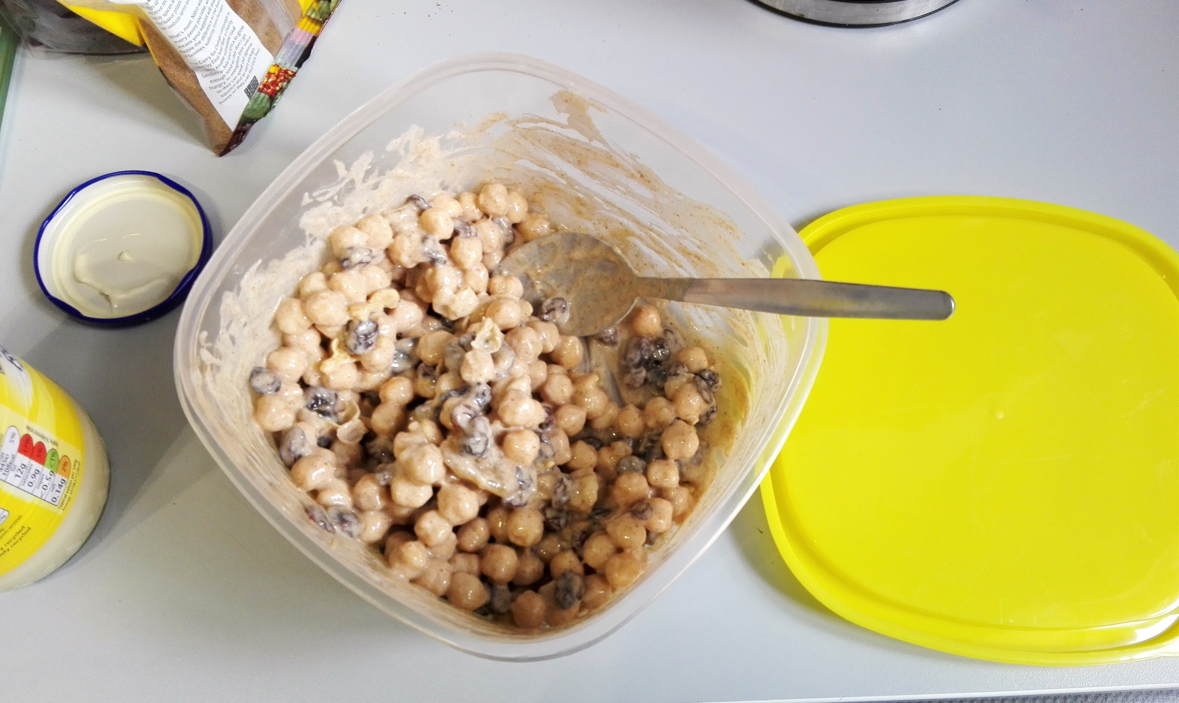 mixed up ingredients for coronation chickpeas deli filler recipe gluten free