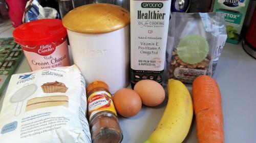 doves farm gluten free self raising flour, brown sugar, cinnamon, eggs, banana, carrot, carotino oil, walnuts