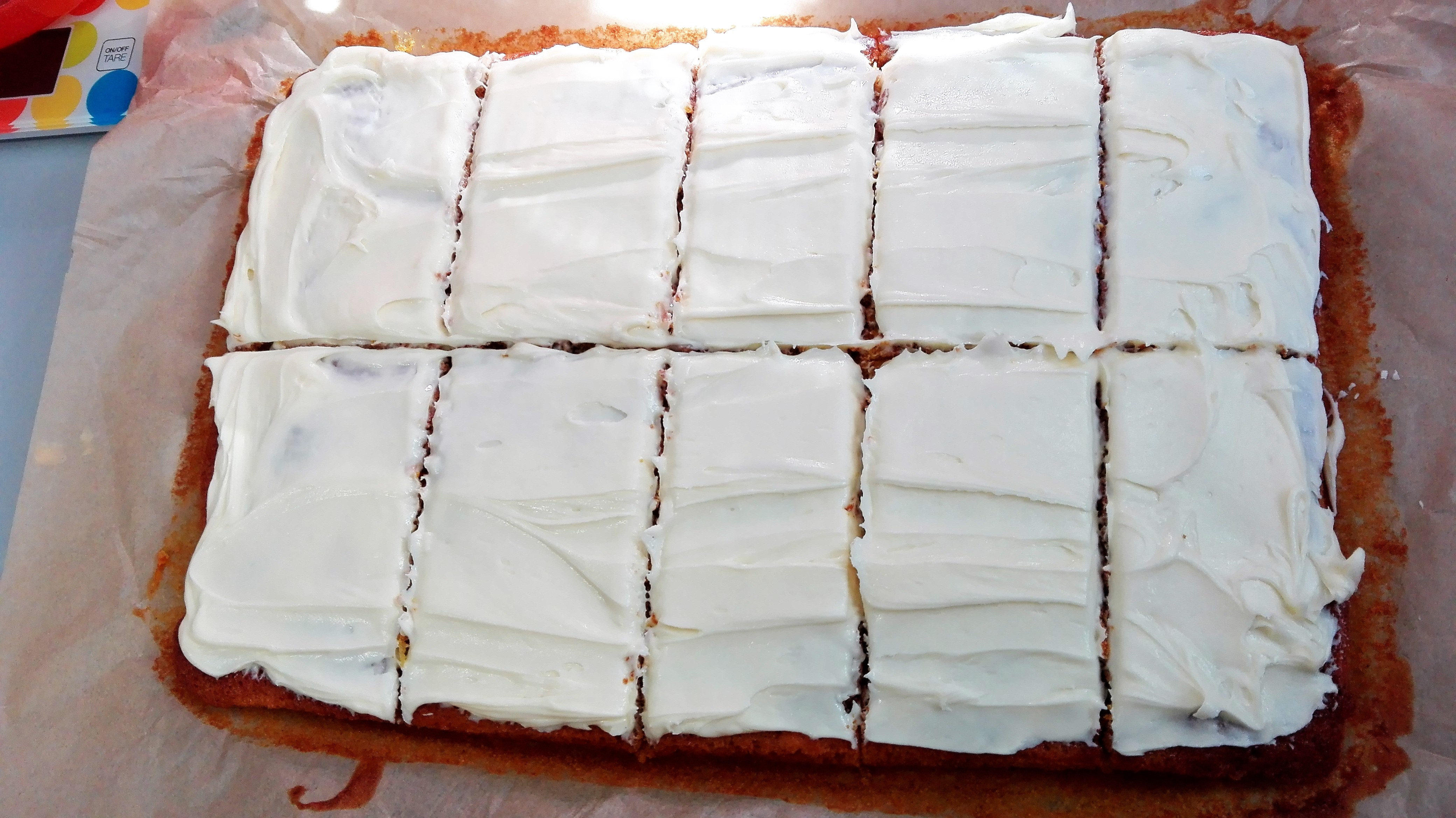 gluten free carrot cake traybake all iced and sliced up