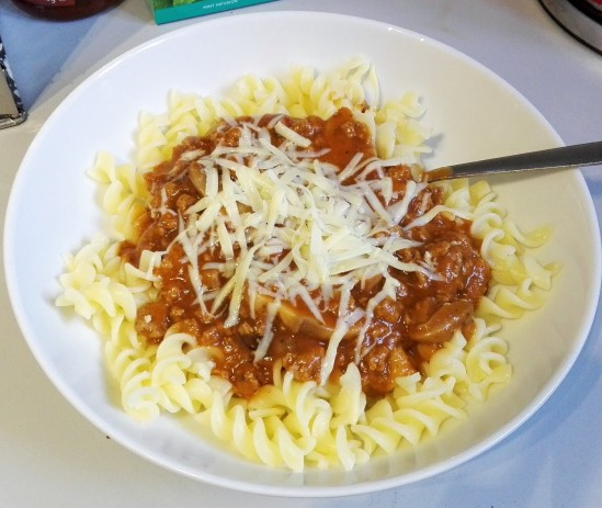 gluten free pasta with quorn bolognaise and grated cheddar