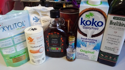 ingredients for the 5 minute chocolate gluten free mug pudding. xylitol, xanthan gum, doves farm flour, maple syrup, vanilla essence, cocoa powder, koko milk and carotino oil