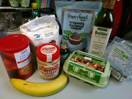Gluten Free chocolate breakfast muffins ingredients: cocoa powder, doves farm self raising flour, peanut butter, vanilla essence, organic coconut sugar, carotino oil, free range eggs and 4 seed mix