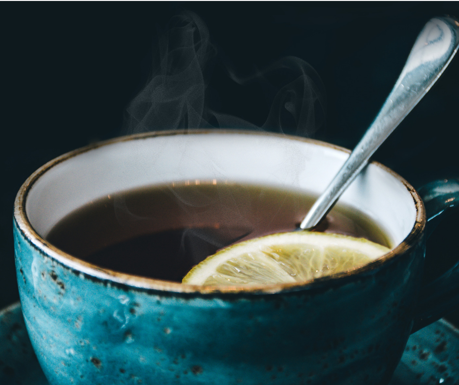 5 Simple Anxiety Hacks For Busy Mums photo of cup of tea with lemon slice steaming invitingly