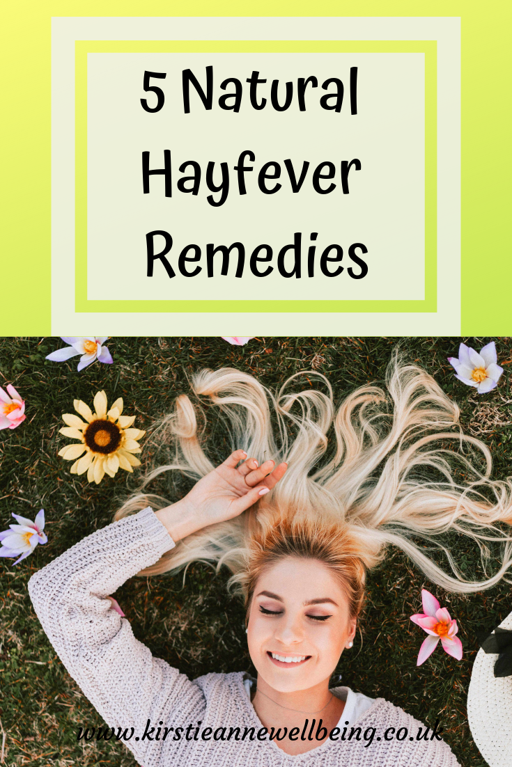 5 Natural Hayfever Remedies pinterest graphic showing smiling woman laying on the grass surrounded by flowers