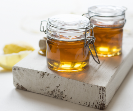 jars of local honey on a kitchen worktop