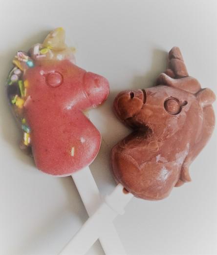 Close up of dairy free vegan sugar free unicorn ice lollies - magical!