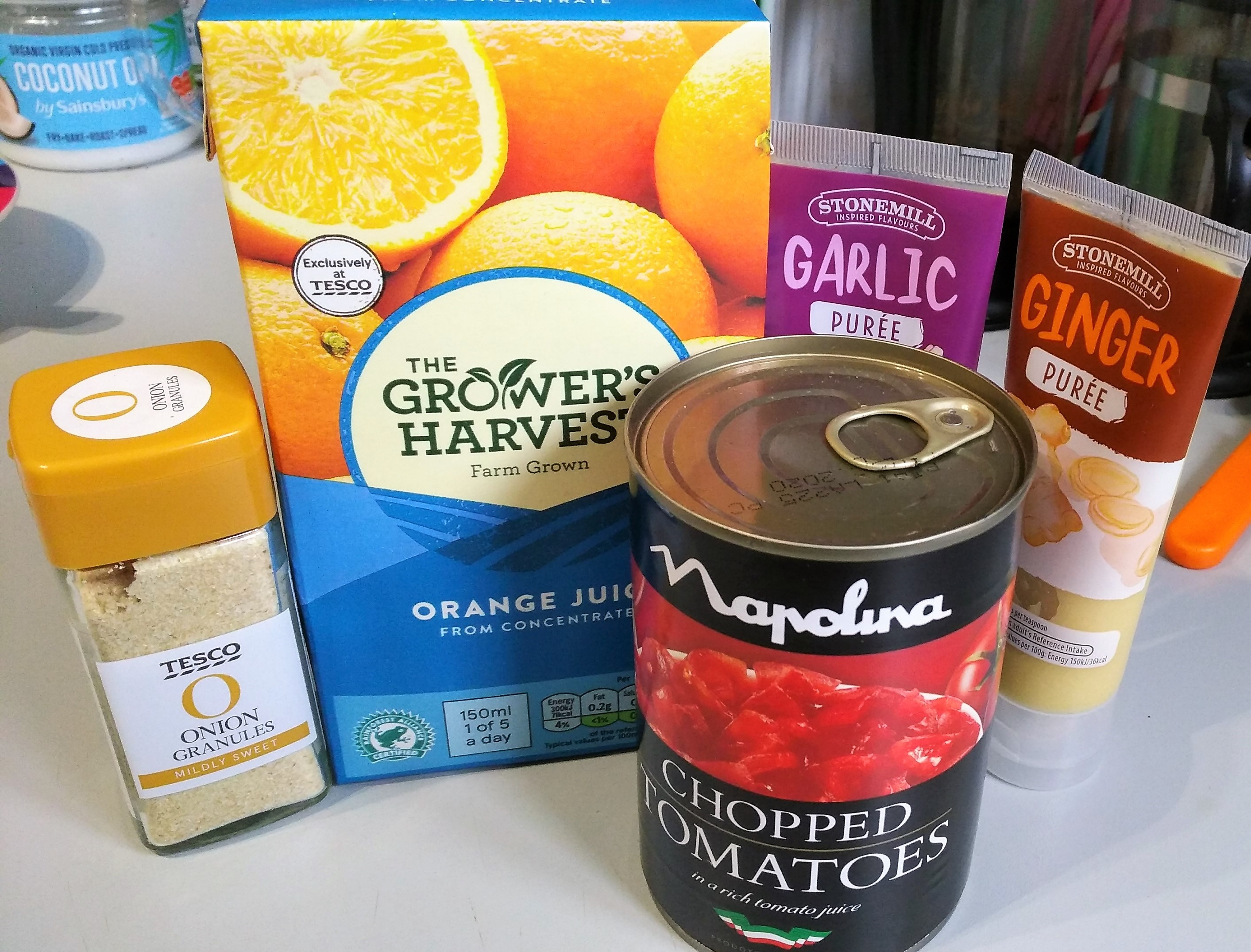 ingredients for tomato and ginger soup recipe - onion granules, orange juice, tinned chopped tomatoes, garlic and ginger puree