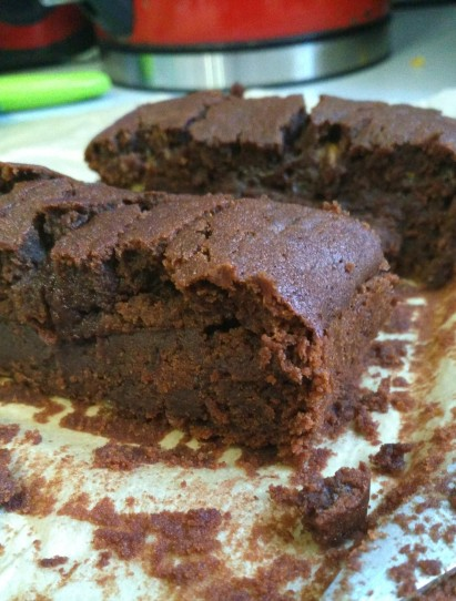 gluten free vegan courgette chocolate brownies sliced on a kitchen worktop. super easy recipe