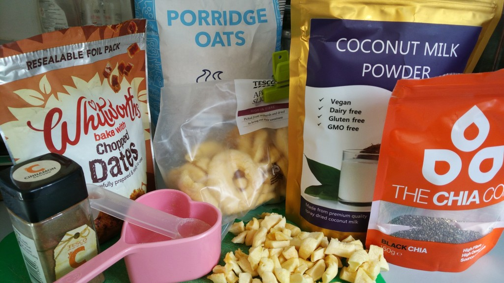 quick and easy gluten free porridge recipe, vegan, plant based breakfast, oatmeal. Ingredients on the counter here - whitworths chopped dates, ground cinnamon, dried chopped apple, coconut milk powder, chia seeds and oats