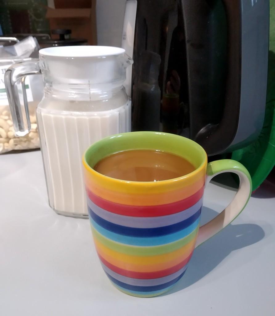 homemade oat milk diy great in coffee in a rainbow mug