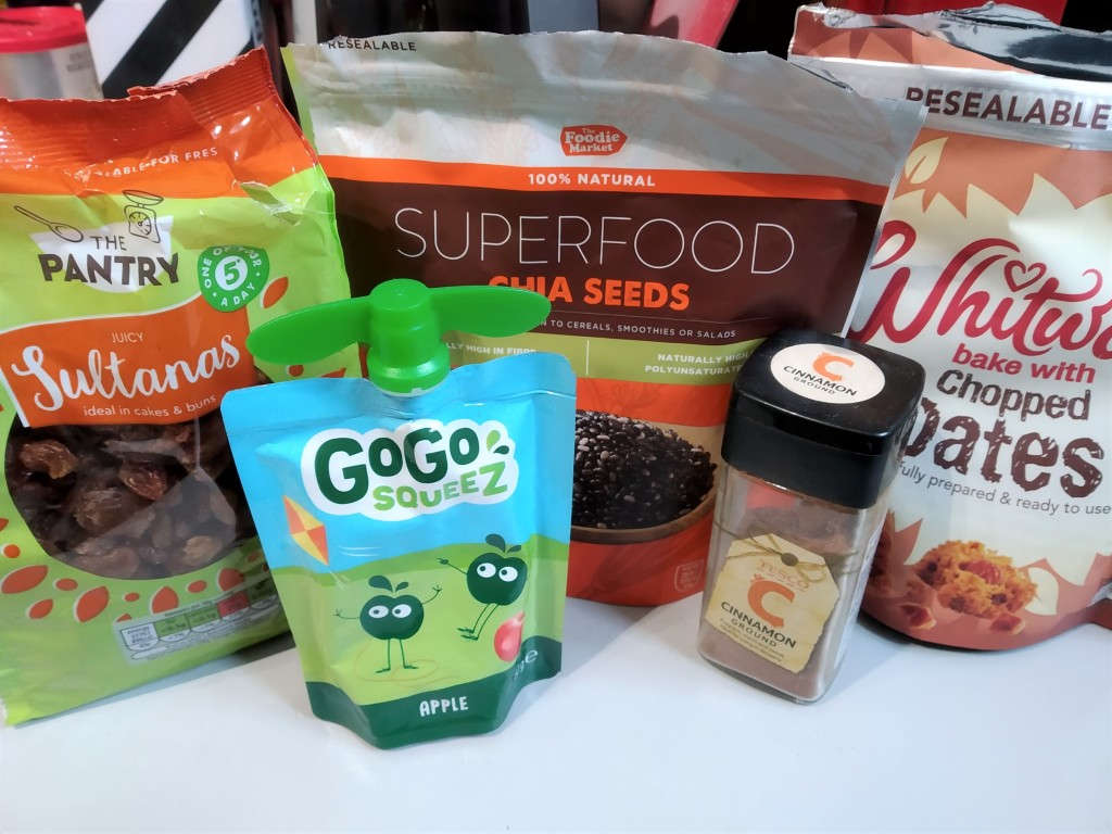 cinnamon and raisin chia jam ingredients - raisins/sultanas, chia seeds, cinnamon, dates and a gogo squeez apple fruit pouch