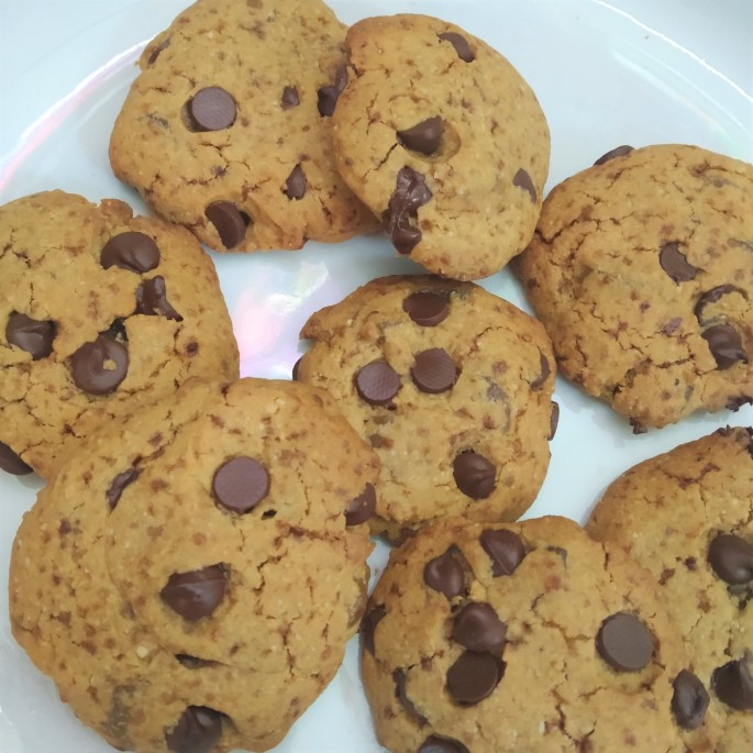 allergy friendly dark chocolate chip cookies with stem ginger on a plate
